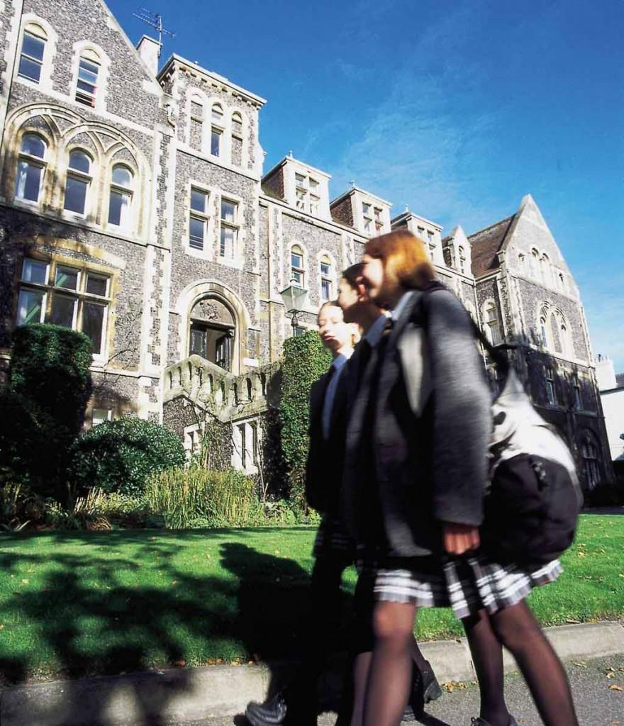 girls-walking-outside-with-bag-on-shoulder